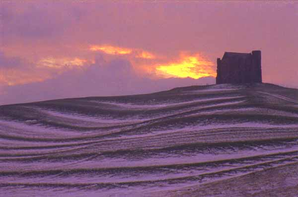 Abbotsbury - St Catherine's Chapel in the snow at Sunset, by Andrew Green